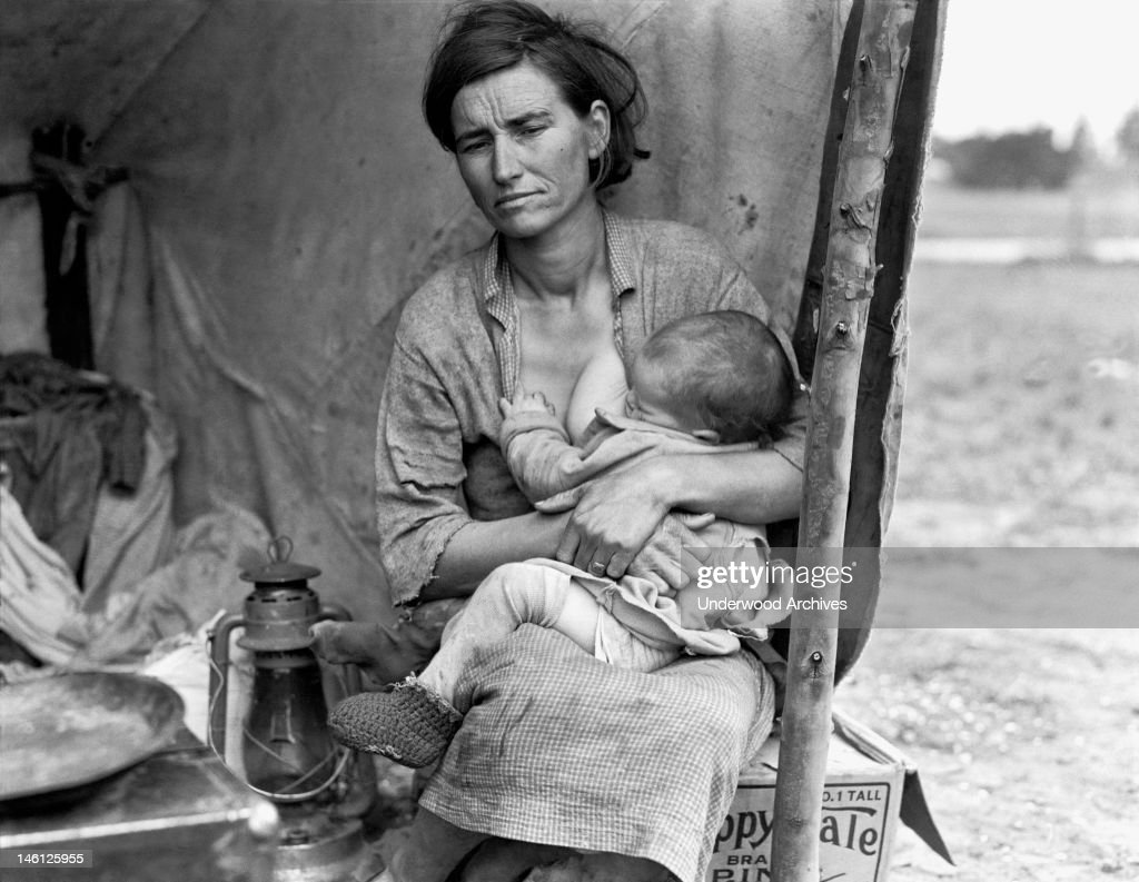 Florence Thompson, age 32, nursing one of her children at a pea pickers camp, Nipomo, California, 1936.