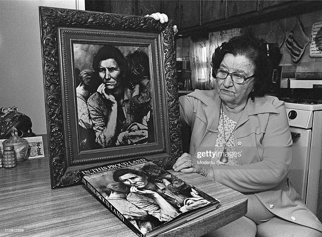 Florence Thompson, the 'Migrant Mother' in Dorothea Lange's famous 1936 photo, holds up her likeness during an interview, October 10, 1978.