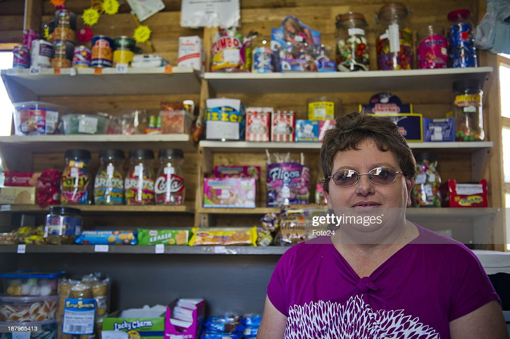 Florence van Niekerk at her spaza shop on November 12, 2013 in Kempton Park, South Africa. She sells airtime, bread, sweets and cigarettes and also takes customers blood pressure; tests for sugar and administers B12 injections. She is the only white person who recently completed a program for spaza shop owners presented by Wits Business School and Grand-Pa. A spaza shop is an informal convenience shop business in South Africa, usually run from home.
