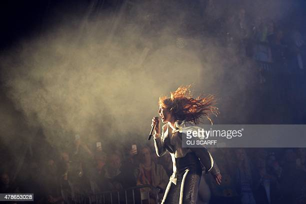 Florence Welch from British band Florence and the Machine perform on the Pyramid Stage on the first official date of the Glastonbury Festival of...