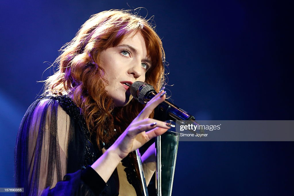 <a gi-track='captionPersonalityLinkClicked' href=/galleries/search?phrase=Florence+Welch&family=editorial&specificpeople=5431574 ng-click='$event.stopPropagation()'>Florence Welch</a> of Florence And The Machine performs live on stsge at 02 Arena on December 5, 2012 in London, England.