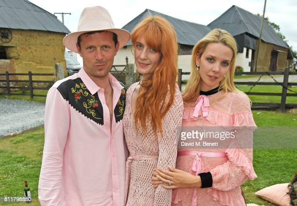 Florence Welch poses with Robert Montgomery and Greta Bellamacina at their wedding on July 8 2017 in Exeter England