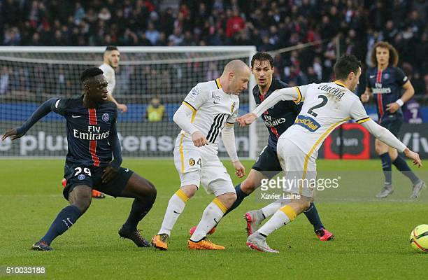Florent Balmont and Sebastien Corchia of Lille LOSC in action with Benjamin Stambouli and JeanKevin Augustin of Paris SaintGermain during the French...