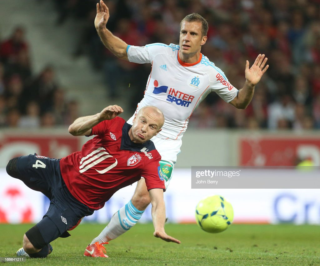 Florent Balmont of Lille and <a gi-track='captionPersonalityLinkClicked' href=/galleries/search?phrase=Benoit+Cheyrou&family=editorial&specificpeople=648473 ng-click='$event.stopPropagation()'>Benoit Cheyrou</a> of Marseille in action during the Ligue 1 match between Lille OSC, LOSC and Olympique de Marseille, OM, at the Grand Stade Lille Metropole on April 14, 2013 in Troyes, France.