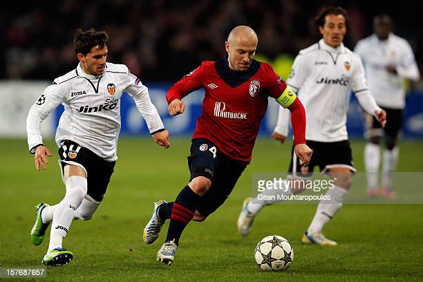 Florent Balmont of Lille and Pablo Piatti of Valencia battle for the ball during the UEFA Champions League Group F match between OSC Lille and...