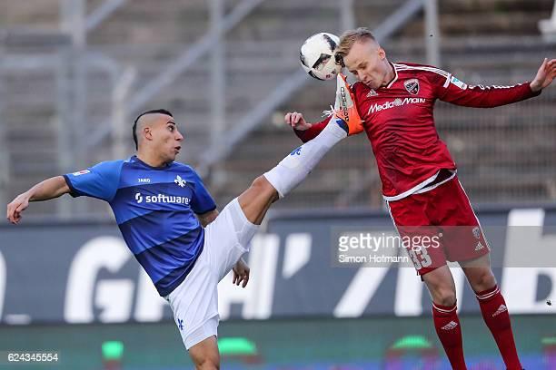 Florent Hadergjonaj of Ingolstadt is challenged by Aenis BenHatira of Darmstadt during the Bundesliga match between SV Darmstadt 98 and FC Ingolstadt...