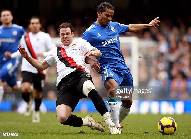 Florent Malouda of Chelsea and Wayne Bridge of Manchester City battle for the ball during the Barclays Premier League match between Chelsea and...