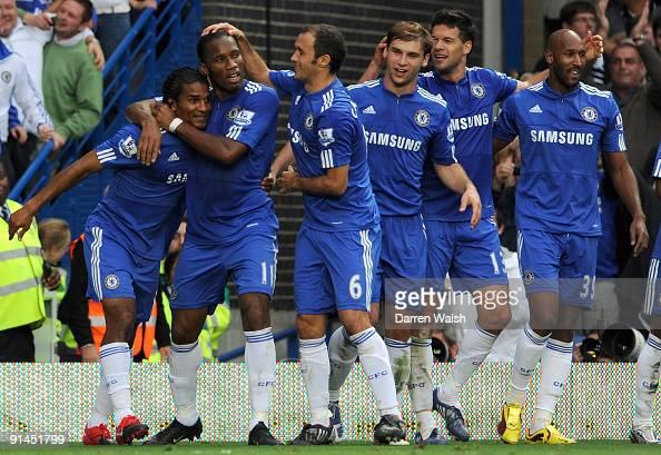 Florent Malouda of Chelsea celebrates after scoring the second goal with teammates Didier Drogba Ricardo Carvalho Branislav Ivanovic Michael Ballack...