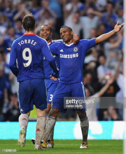 Florent Malouda of Chelsea celebrates scoring his team's third goal with team mates Ashley Cole and Fernando Torres during the Barclays Premier...