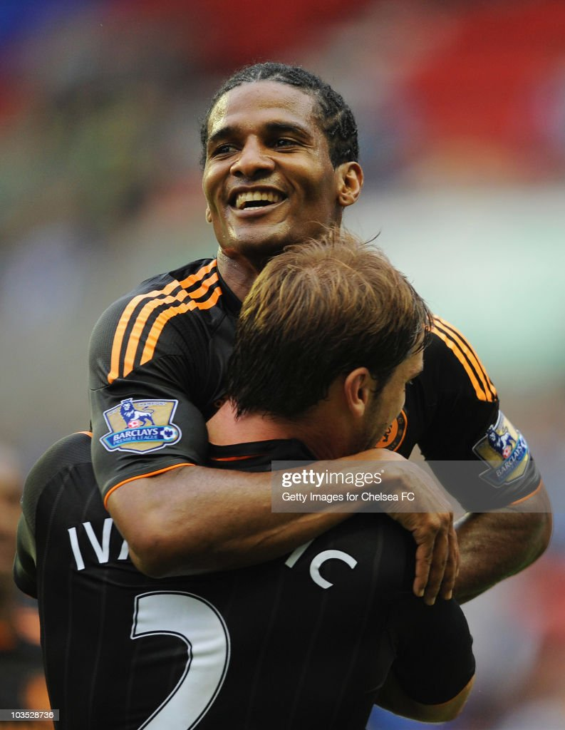 Florent Malouda of Chelsea celebrates with Branislav Ivanovic (L) as he scores their first goal during the Barclays Premier League match between Wigan Athletic and Chelsea at DW Stadium on August 21, 2010 in Wigan, England.