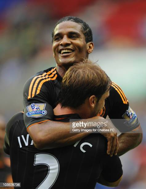 Florent Malouda of Chelsea celebrates with Branislav Ivanovic as he scores their first goal during the Barclays Premier League match between Wigan...