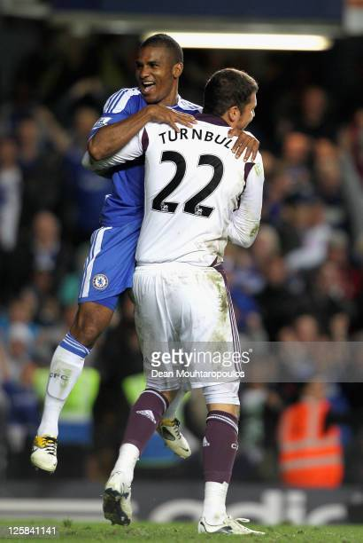 Florent Malouda of Chelsea celebrates with goalkeeper Ross Turnbull after a penalty shootout victory during the Carling Cup Third Round match between...