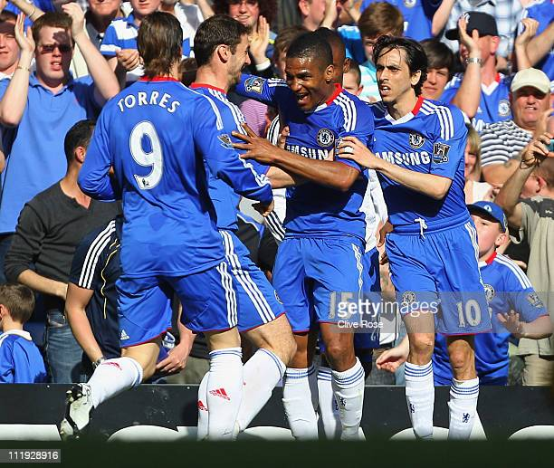 Florent Malouda of Chelsea celebrates with team mates as he scores their first goal during the Barclays Premier League match between Chelsea and...