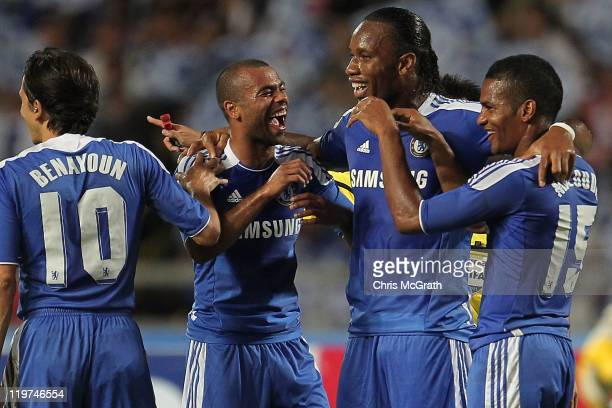 Florent Malouda of Chelsea celebrates with team mates Didier Drogba and Ashley Cole after scoring a goal during the preseason friendly match between...