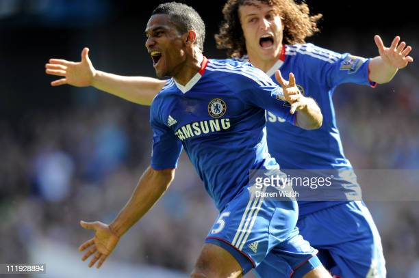 Florent Malouda of Chelsea celebrates with teammate David Luiz after scoring the opening goal during the Barclays Premier League match between...