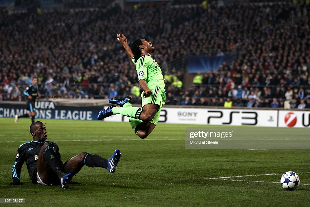<a gi-track='captionPersonalityLinkClicked' href=/galleries/search?phrase=Florent+Malouda&family=editorial&specificpeople=228109 ng-click='$event.stopPropagation()'>Florent Malouda</a> of Chelsea is brought down in the area by <a gi-track='captionPersonalityLinkClicked' href=/galleries/search?phrase=Souleymane+Diawara&family=editorial&specificpeople=695613 ng-click='$event.stopPropagation()'>Souleymane Diawara</a> of Marseille, but Referee Vladislav Bezborodov of Russia refuses to award the penalty during the UEFA Champions League Group F match between Marseille and Chelsea at the Stade Velodrome on December 8, 2010 in Marseille, France.