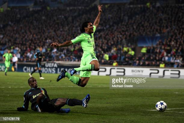Florent Malouda of Chelsea is brought down in the area by Souleymane Diawara of Marseille but Referee Vladislav Bezborodov of Russia refuses to award...