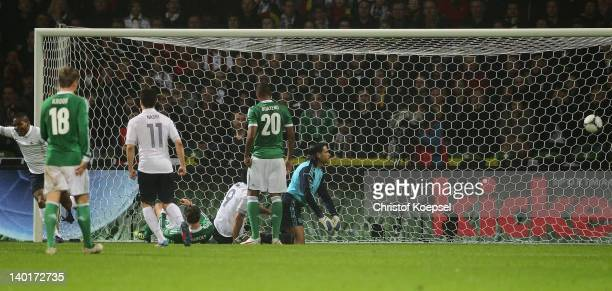 Florent Malouda of France scores the second goal against Tim Wiese of Germany during the International friendly match between Germany and France at...