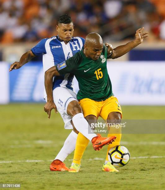 Florent Malouda of French Guiana dribbles the ball as Bryan Acosta of Honduras pressures him in the first half at BBVA Compass Stadium on July 11...
