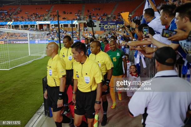 Florent Malouda of French Guiana leads his country out onto the pitch prior to the 2017 CONCACAF Gold Cup Group A match between Honduras and French...