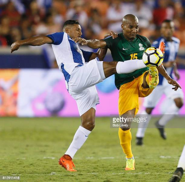 Florent Malouda of French Guiana posseses the ball as Bryan Acosta of Honduras attempts to take it away in the first half at BBVA Compass Stadium on...