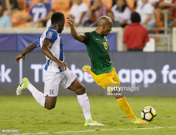 Florent Malouda of French Guiana shoots on goal as Anthony Lozano of Honduras pressures him in the second half at BBVA Compass Stadium on July 11...