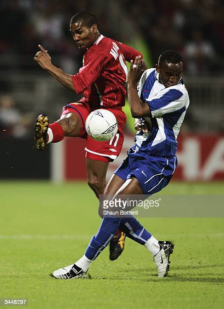 Florent Malouda of Lyon clears the ball as Benni McCarthy of FC Porto makes a challenge during the UEFA Champions League Quarter Final Second Leg...