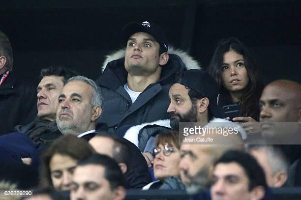 Florent Manaudou and Ambre Baker below Marc Lavoine Cyril Hanouna attend the French Ligue 1 match between Olympique Lyonnais and Paris SaintGermain...