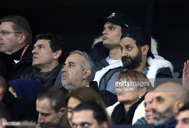 Florent Manaudou below Marc Lavoine Cyril Hanouna attend the French Ligue 1 match between Olympique Lyonnais and Paris SaintGermain at Parc OL...