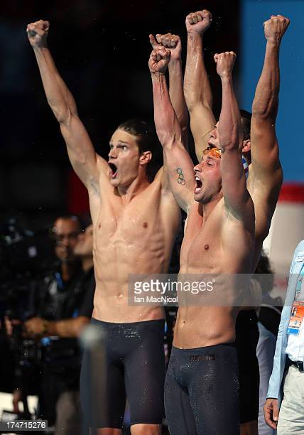 Florent Manaudou Fabien Gilot and Yannick Agnel celebrate as France win the Mens 4x100m Freestyle at the Palau Sant Jordi on day nine of the 15th...