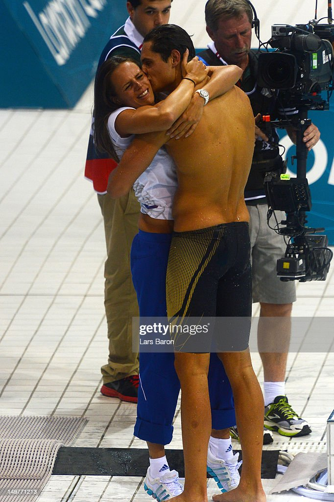 Florent Manaudou of France embraces his sister Laure Manaudou after winning the Men's 50m Freestyle Final on Day 7 of the London 2012 Olympic Games...