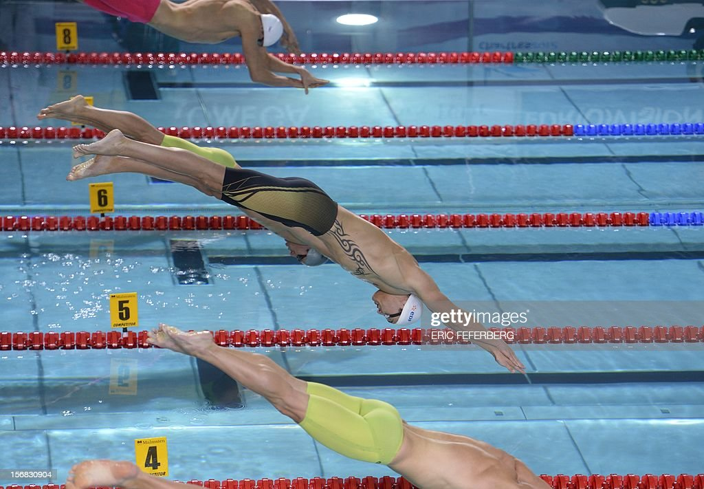 Florent Manaudou (C) takes the start of the men's 50m freestyle semi-final at the European Short Course Swimming Championships on November 22, 2012 in Chartres.