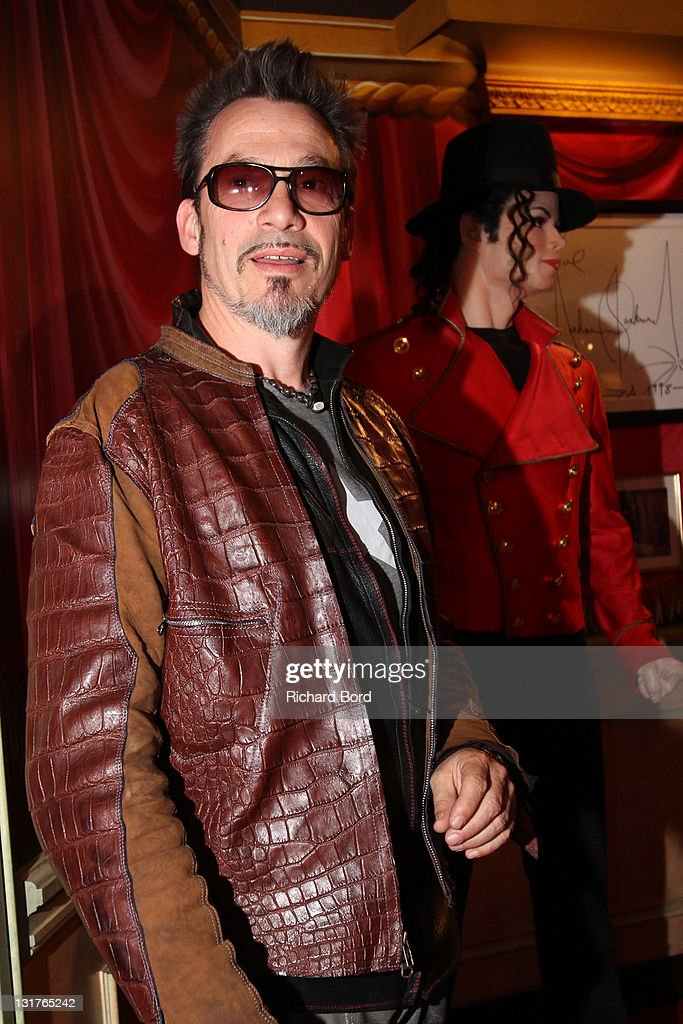 Florent Pagny poses next to the Michael Jackson wax figure as he attends the Philippe Starck wax figure unveilling at Musee Grevin on June 15, 2010 in Paris, France.