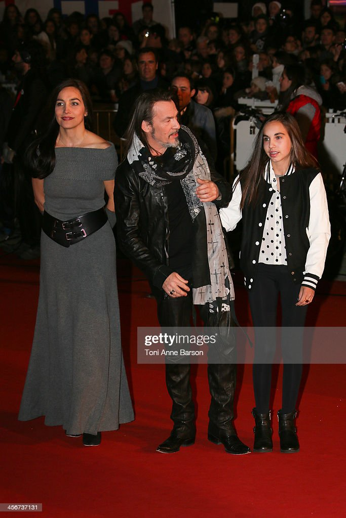Florent Pagny with wife Azucena Camano and daughter arrive at the 15th NRJ Music Awards at the Palais des Festivals on December 14, 2013 in Cannes, France.