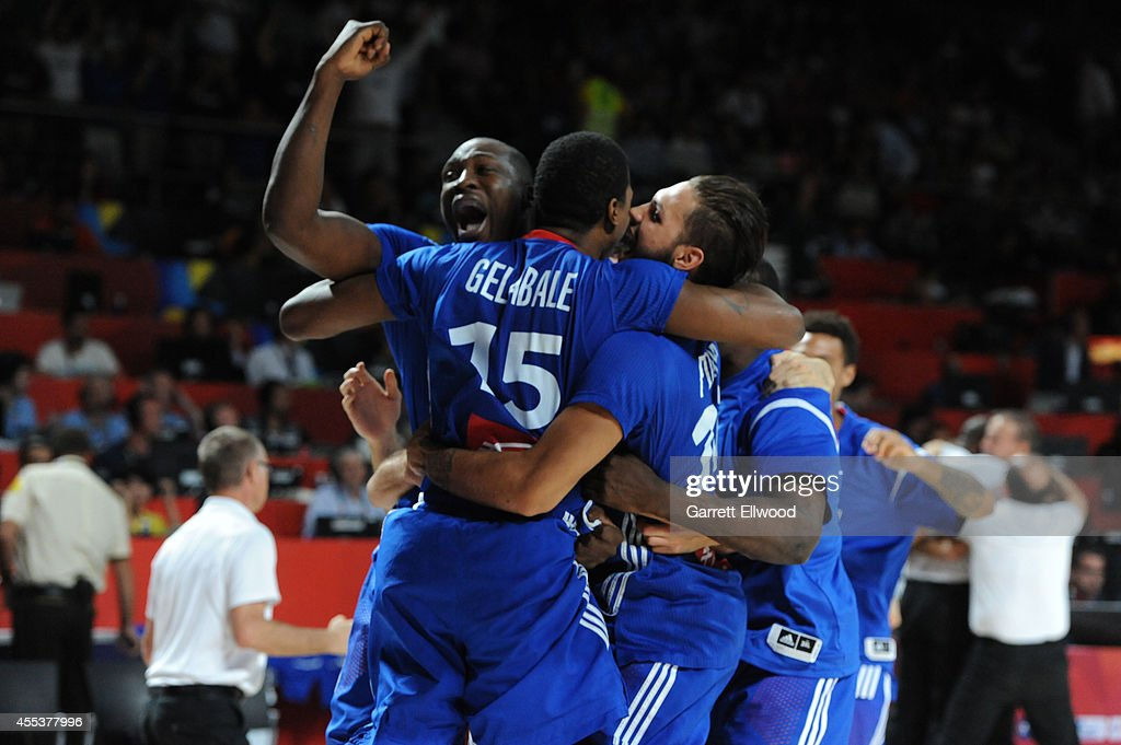 <a gi-track='captionPersonalityLinkClicked' href=/galleries/search?phrase=Florent+Pietrus&family=editorial&specificpeople=713034 ng-click='$event.stopPropagation()'>Florent Pietrus</a>, <a gi-track='captionPersonalityLinkClicked' href=/galleries/search?phrase=Evan+Fournier&family=editorial&specificpeople=7285162 ng-click='$event.stopPropagation()'>Evan Fournier</a> and <a gi-track='captionPersonalityLinkClicked' href=/galleries/search?phrase=Mickael+Gelabale&family=editorial&specificpeople=700549 ng-click='$event.stopPropagation()'>Mickael Gelabale</a> of the France National Team celebrates after defeating the Lithuania National Team in the 2014 FIBA World Cup Third Place game at Palacio de Deportes on September 13, 2014 in Madrid, Spain.