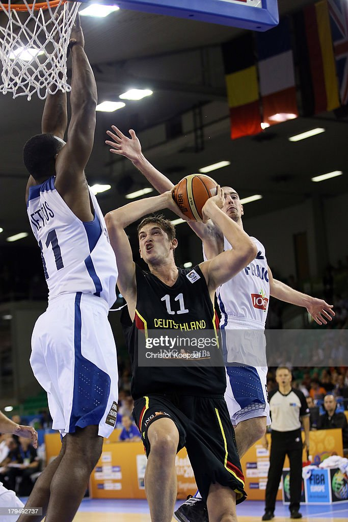 Florent Pietrus of France defends against <a gi-track='captionPersonalityLinkClicked' href=/galleries/search?phrase=Tibor+Pleiss&family=editorial&specificpeople=4538830 ng-click='$event.stopPropagation()'>Tibor Pleiss</a> of Gemany during the FIBA European Championships 2013 first round group A match between France and Germany at Tivoli Arena on September 4, 2013 in Ljubljana, Slovenia.
