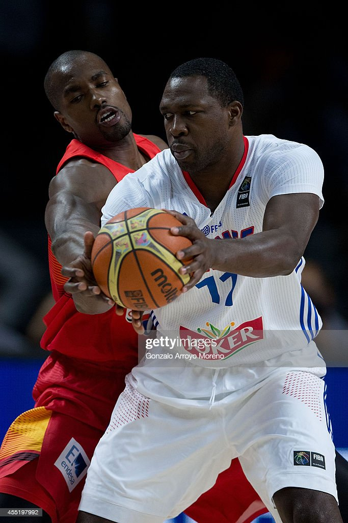 <a gi-track='captionPersonalityLinkClicked' href=/galleries/search?phrase=Florent+Pietrus&family=editorial&specificpeople=713034 ng-click='$event.stopPropagation()'>Florent Pietrus</a> of France (R) drives against <a gi-track='captionPersonalityLinkClicked' href=/galleries/search?phrase=Serge+Ibaka&family=editorial&specificpeople=5133378 ng-click='$event.stopPropagation()'>Serge Ibaka</a> (L) of Spain during the 2014 FIBA World Basketball Championship quarter final match between France and Spain at Palacio de los Deportes on September 10, 2014 in Madrid, Spain.