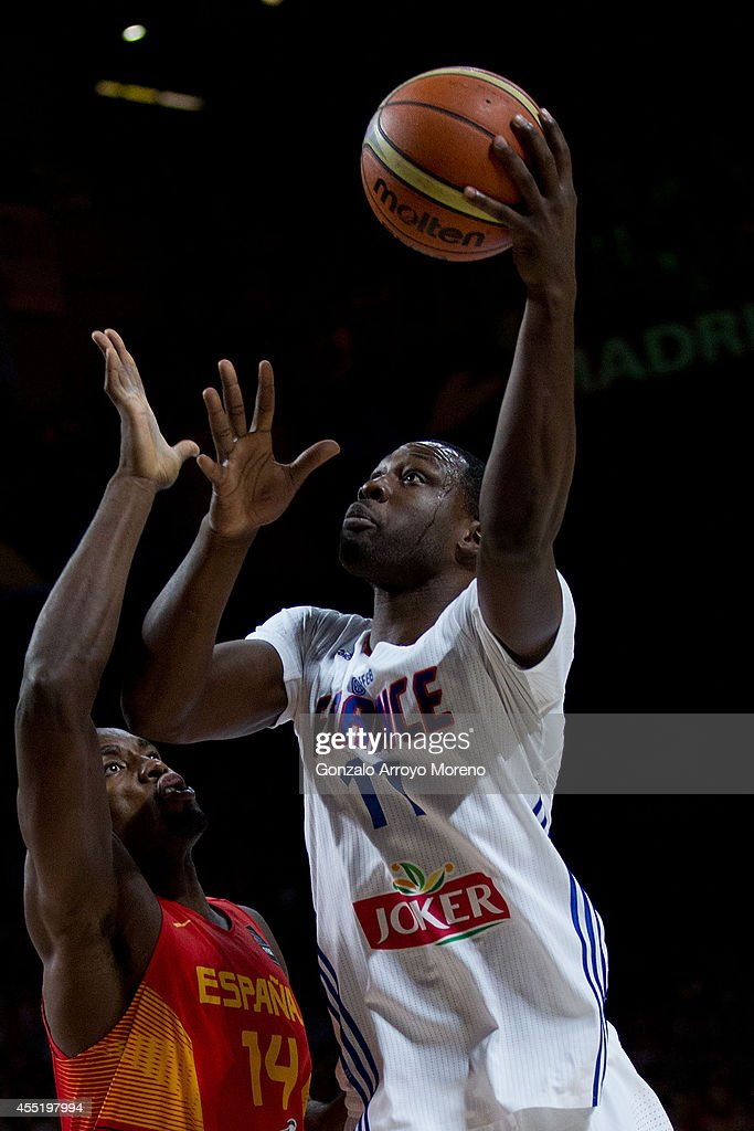 <a gi-track='captionPersonalityLinkClicked' href=/galleries/search?phrase=Florent+Pietrus&family=editorial&specificpeople=713034 ng-click='$event.stopPropagation()'>Florent Pietrus</a> (R) of France shoots against <a gi-track='captionPersonalityLinkClicked' href=/galleries/search?phrase=Serge+Ibaka&family=editorial&specificpeople=5133378 ng-click='$event.stopPropagation()'>Serge Ibaka</a> (L) of Spain during the 2014 FIBA World Basketball Championship quarter final match between France and Spain at Palacio de los Deportes on September 10, 2014 in Madrid, Spain.