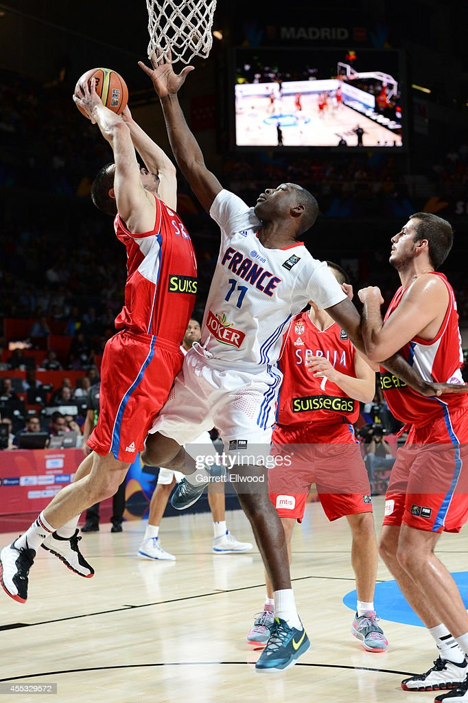 <a gi-track='captionPersonalityLinkClicked' href=/galleries/search?phrase=Florent+Pietrus&family=editorial&specificpeople=713034 ng-click='$event.stopPropagation()'>Florent Pietrus</a> #11 of the France National Team goes for a block against the Serbia National Team at Palacio de Deportes on September 12, 2014 in Madrid, Spain.
