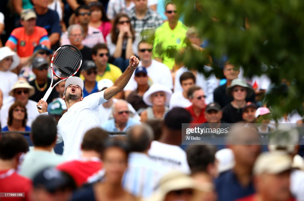 Florent Serra of France serves against Feliciano Lopez of Spain during their first round match on Day One of the 2013 US Open at USTA Billie Jean King National Tennis Center on August 26, 2013 in the Flushing neighborhood of the Queens borough of New York City.