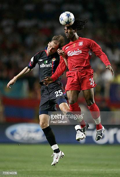 Florent Sinama Pongolle of Liverpool battles for the ball with Elvir Rahimic of CSKA Moscow during the UEFA Super Cup match between Liverpool and...
