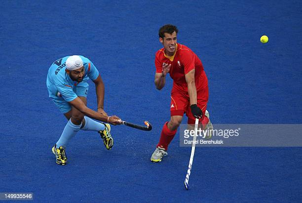 Florent van Aubel of Belgium and Sandeep Singh of India challenge for the ball during the Men's Hockey match between Belgium and India on Day 11 of...