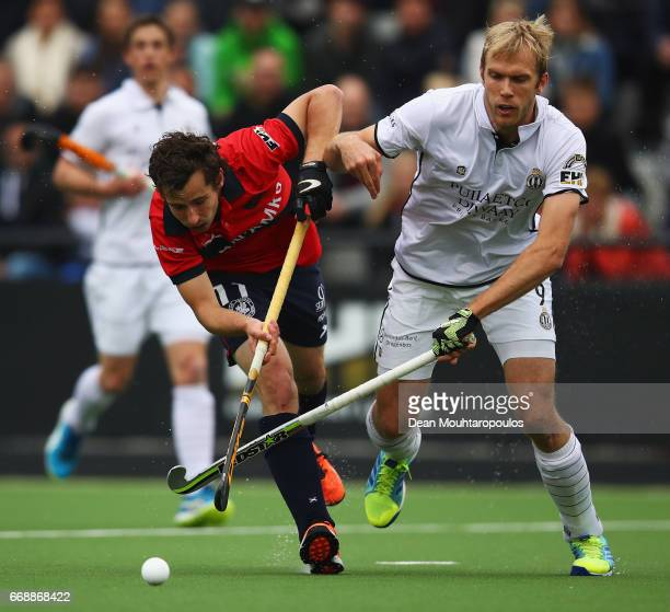 Florent Van Aubel of KHC Dragons battles for the ball with Conor Harte of Racing Club de Bruxelles during the Euro Hockey League KO16 match between...