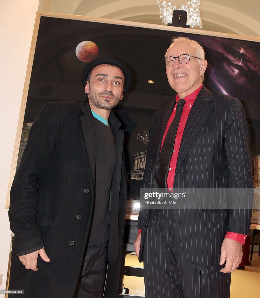Florentin Georgescu aka Geo Fiorenti (L) and Gianni Bulgari attend the 'Luce Preziosa' presentation at the GB ENIGMA by Gianni Bulgari boutique on December 13, 2013 in Rome, Italy. Luce Preziosa is an inspiring christmas jewellery and light TechoArt opera by the artist Geo Florenti.