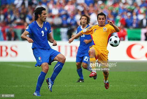 Florentin Petre of Romania and Fabio Grosso of Italy battle for the ball during the UEFA EURO 2008 Group C match between Italy and Romania at...