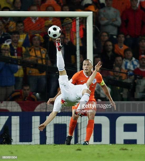 Florentin Petre of Romania with Jon Heitinga during the EURO 2008 preliminary round group C match between the Netherlands and Romania played at the...