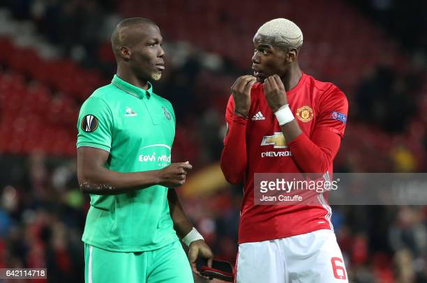 Florentin Pogba of SaintEtienne and his brother Paul Pogba of Manchester United talk to each other following the UEFA Europa League Round of 32 first...