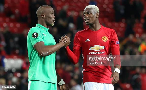 Florentin Pogba of SaintEtienne and his brother Paul Pogba of Manchester United get together following the UEFA Europa League Round of 32 first leg...