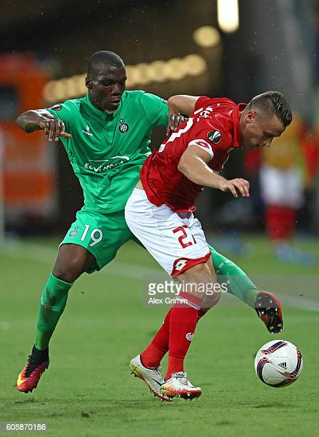 Florentin Pogba of SaintEtienne challenges Christian Clemens of FSV Mainz 05 during the UEFA Europa League Group C match between 1 FSV Mainz 05 and...