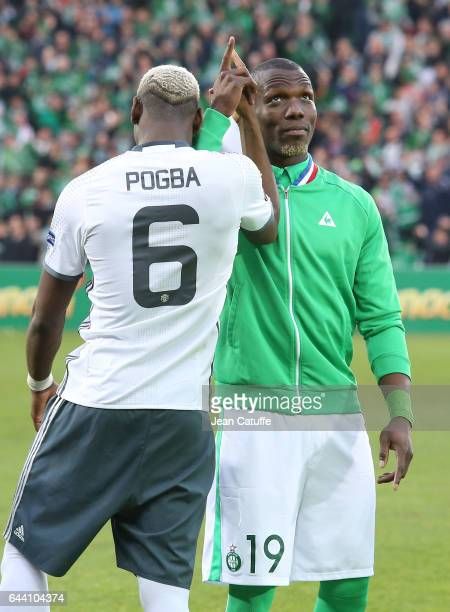Florentin Pogba of SaintEtienne greets his brother Paul Pogba of Manchester United before the UEFA Europa League Round of 32 second leg match between...